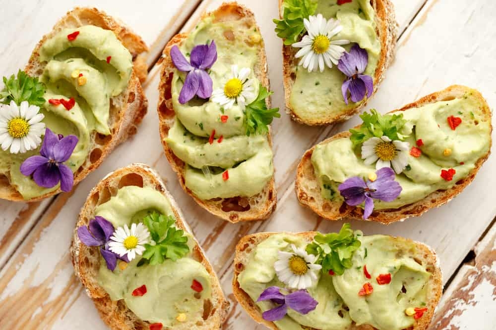 avocado toast canapes with edible flowers